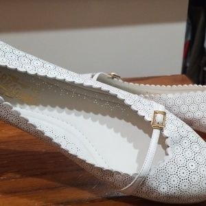White Ferragamo flats made in Italy